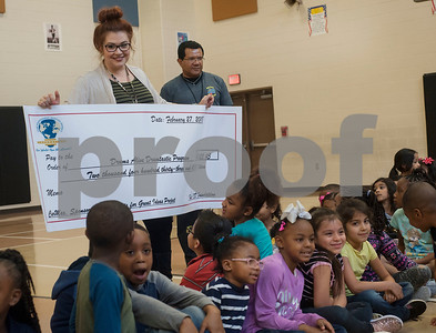 Jones Elementary School teachers Calla Owen and Andre Lampton receive an oversized check for a grant from Tyler ISD Foundation for the Drums Alive Drumtastic Program on Tuesday Feb. 27, 2018. The Tyler ISD Foundation Grant Patrol visited nine Tyler ISD campuses awarding ten grants totaling more than $30,000 to support classroom learning.  (Sarah A. Miller/Tyler Morning Telegraph)