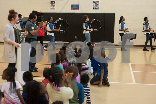 The John Tyler High School band marches at Jones Elementary School during a visit from the Tyler ISD Foundation to give the school a grant for the Drums Alive Drumtastic Program on Tuesday Feb. 27, 2018. The Tyler ISD Foundation Grant Patrol visited nine Tyler ISD campuses awarding ten grants totaling more than $30,000 to support classroom learning.  (Sarah A. Miller/Tyler Morning Telegraph)