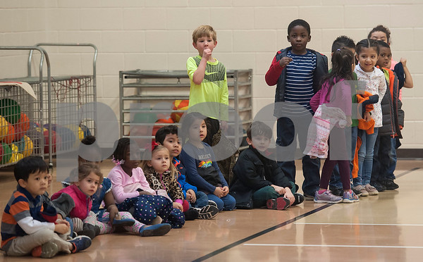 Students at Jones Elementary School react to a surprise performance from the John Tyler High School band and Robert E. Lee cheerleaders as the Tyler ISD Foundation makes a grant patrol stop at their school Tuesday Feb. 27, 2018. The Tyler ISD Foundation Grant Patrol visited nine Tyler ISD campuses awarding ten grants totaling more than $30,000 to support classroom learning.   (Sarah A. Miller/Tyler Morning Telegraph)