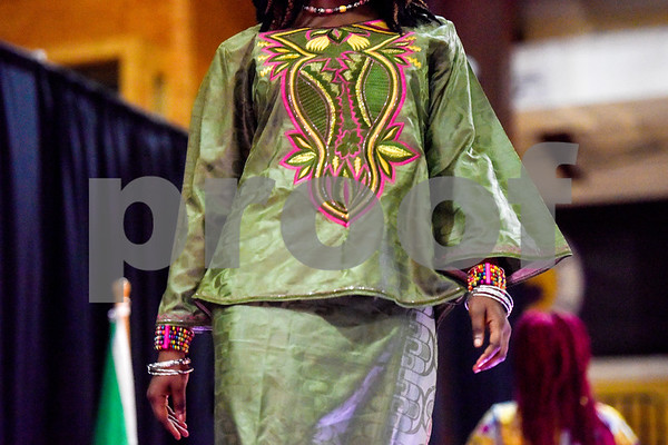 A model walks down the catwalk during the African Fashion Show at Texas College in Tyler, Texas, on Wednesday, Feb. 28, 2018. The fashion show was held as part of Texas College's International Student Association Week. (Chelsea Purgahn/Tyler Morning Telegraph)
