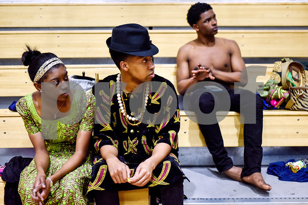 Mya Butcher, Arthur Ward and Jeremiah Jones sit backstage and wait for the African Fashion Show to begin at Texas College in Tyler, Texas, on Wednesday, Feb. 28, 2018. The fashion show was held as part of Texas College's International Student Association Week. (Chelsea Purgahn/Tyler Morning Telegraph)