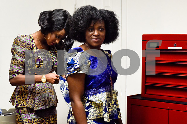 Chasey Shepard helps Monica Dorsey zip up her outfit before the African Fashion Show at Texas College in Tyler, Texas, on Wednesday, Feb. 28, 2018. The fashion show was held as part of Texas College's International Student Association Week. (Chelsea Purgahn/Tyler Morning Telegraph)