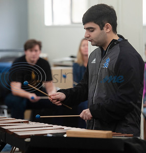 "All Saints Episcopal School student Ali Hashemi plays the xylophone with the drum line during a special workshop with professional percussionist Mark Shelton (not pictured) on Wednesday Feb. 6, 2019. The drummers worked on an arrangement of ""The Entertainer"" by Scott Joplin for the upcoming Solo and Ensemble contest.   (Sarah A. Miller/Tyler Morning Telegraph)"