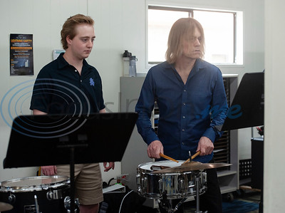 "All Saints Episcopal School student Jack Pogue watches as professional percussionist Mark Shelton works with him on the snare drum on Wednesday Feb. 6, 2019. Shelton held a workshop for the drum line. They worked on an arrangement of ""The Entertainer"" by Scott Joplin for the upcoming Solo and Ensemble contest.  (Sarah A. Miller/Tyler Morning Telegraph)"
