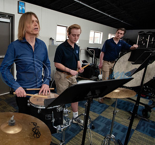 "Professional percussionist, Mark Shelton listens to the sound of the tenor drum as he works with members of the drum line on Wednesday Feb. 6, 2019. The drummers worked on an arrangement of ""The Entertainer"" by Scott Joplin for the upcoming Solo and Ensemble contest. Pictured are students Jack Pogue and Bryce Mitcham.   (Sarah A. Miller/Tyler Morning Telegraph)"