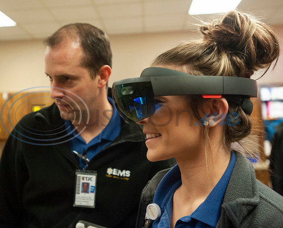 Tyler Junior College paramedic education school student Bart Mallette guides student Shelby Smith through a scenario of a man having a seizure as she views a virtual patient superimposed over a physical mannequin using VR goggles in their class on Tuesday Feb. 5, 2019. Students use VR technology to set up a medical scenario that allows them see if their work improves the patient's situation, keeps it the same, or makes it worse.   (Sarah A. Miller/Tyler Morning Telegraph)