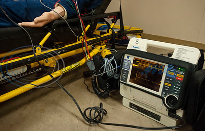 Tyler Junior College paramedic education school students use VR technology to set up a medical scenario that allows them to view a virtual patient superimposed over a physical mannequin and to see if their work improves the patient's situation, keeps it the same, or makes it worse.   (Sarah A. Miller/Tyler Morning Telegraph)