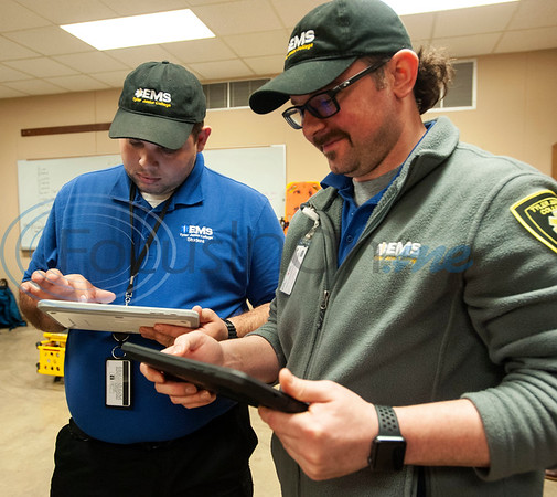 Tyler Junior College paramedic education school students  Michael Smith holds a tablet showing a virtual patient superimposed on top of a physical mannequin and Aaron Beal holds a tablet showing a vitals monitor during class on Tuesday Feb. 5, 2019. Students use VR technology to set up a medical scenario that allows them see if their work improves the patient's situation, keeps it the same, or makes it worse.   (Sarah A. Miller/Tyler Morning Telegraph)