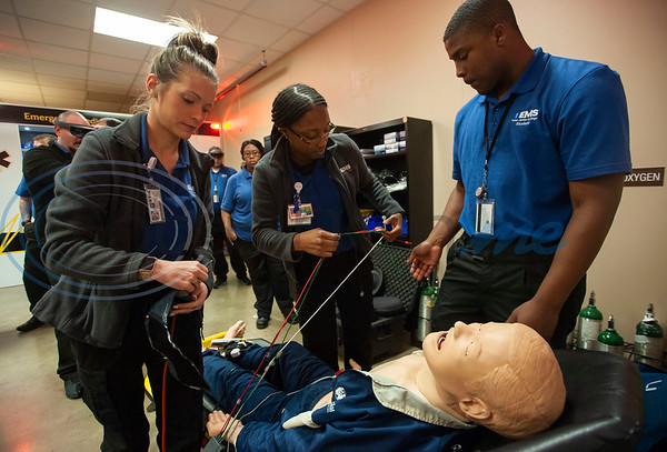 Tyler Junior College paramedic education school students Shelby Smith, Cazmen Edwards and Nicklolous Pope connect an EKG to a mannequin in their class on Tuesday Feb. 5, 2019. Students use VR technology to set up a medical scenario that allows them see if their work improves the patient's situation, keeps it the same, or makes it worse.   (Sarah A. Miller/Tyler Morning Telegraph)