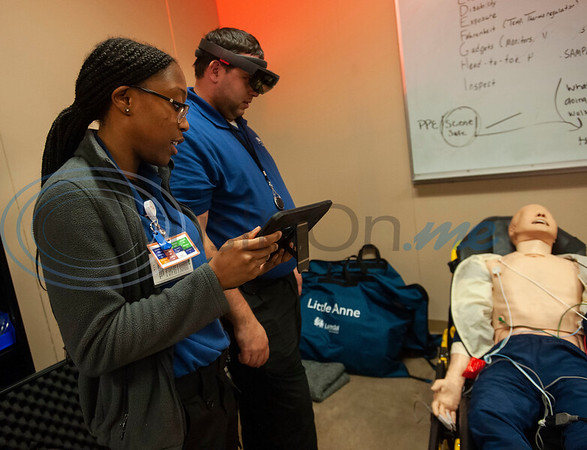 Tyler Junior College paramedic education school student Cazmen Edwards guides student Michael Smith through a scenario of a man having a seizure as he views a virtual patient superimposed over a physical mannequin using VR goggles in their class on Tuesday Feb. 5, 2019. Students use VR technology to set up a medical scenario that allows them see if their work improves the patient's situation, keeps it the same, or makes it worse.   (Sarah A. Miller/Tyler Morning Telegraph)