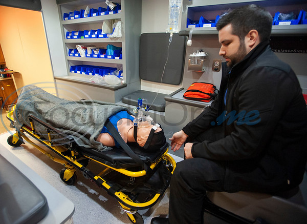 Tyler Junior College paramedic education school student Josh Miller works with a mannequin inside a model of an ambulance during class on Tuesday Feb. 5, 2019.   (Sarah A. Miller/Tyler Morning Telegraph)