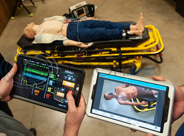 Tyler Junior College paramedic education school students Aaron Beal holds a tablet showing a vitals monitor and Michael Smith holds a tablet showing a virtual patient superimposed on top of a physical mannequin during class on Tuesday Feb. 5, 2019. Students use VR technology to set up a medical scenario that allows them see if their work improves the patient's situation, keeps it the same, or makes it worse.   (Sarah A. Miller/Tyler Morning Telegraph)