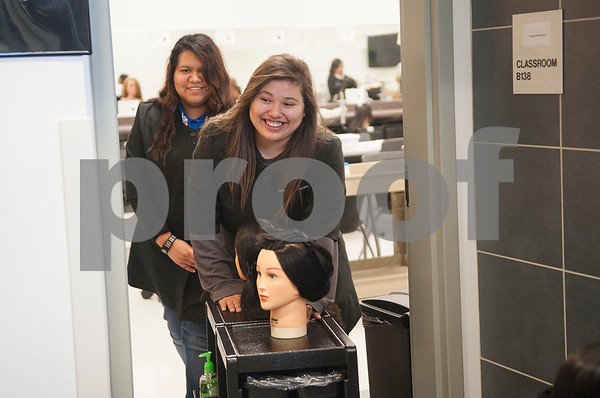 John Tyler High School junior Abigail Meneses rolls her hair cutting cart from the classroom out to the salon area at cosmetology class Tuesday Jan. 26, 2016 at the Tyler ISD Career and Technology Center.  (Sarah A. Miller/Tyler Morning Telegraph)
