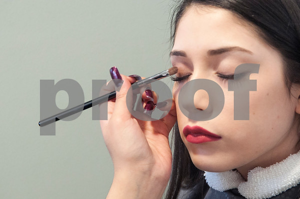 John Tyler High School junior Jacky Tello practices her eyeshadow skills on classmate Zayda Flores, also a JT junior, during cosmetology class Tuesday Jan. 26, 2016 at the Tyler ISD Career and Technology Center.  (Sarah A. Miller/Tyler Morning Telegraph)