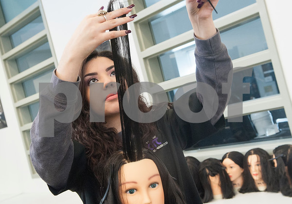 John Tyler High School junior Jacky Tello practices a haircut on a mannequin during cosmetology class Tuesday Jan. 26, 2016 at the Tyler ISD Career and Technology Center.  (Sarah A. Miller/Tyler Morning Telegraph)