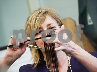 Teacher Leigh Ann Crump demonstrates a hair cut to her cosmetology class Tuesday Jan. 26, 2016 at the Tyler ISD Career and Technology Center.  (Sarah A. Miller/Tyler Morning Telegraph)