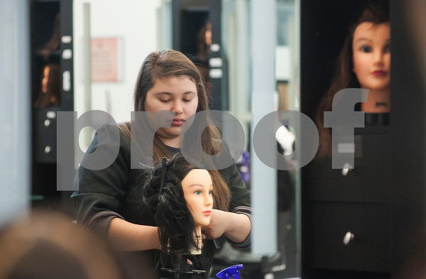 John Tyler High School junior Abigail Meneses does a haircut on a mannequin in the salon area at cosmetology class Tuesday Jan. 26, 2016 at the Tyler ISD Career and Technology Center.  (Sarah A. Miller/Tyler Morning Telegraph)