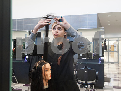 John Tyler High School junior Savanna Rogers practices a haircut on a mannequin during cosmetology class Tuesday Jan. 26, 2016 at the Tyler ISD Career and Technology Center.  (Sarah A. Miller/Tyler Morning Telegraph)