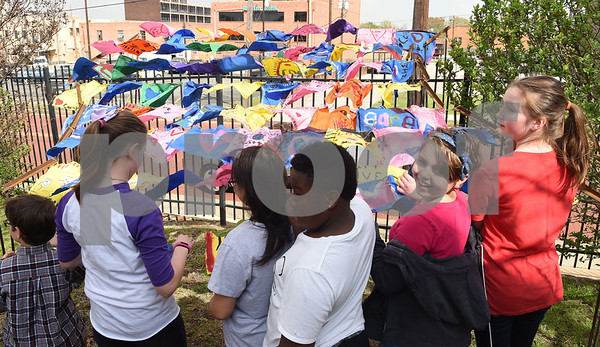 Caldwell Elementary Arts Academy students view decorated flags made by classmates hanging on a collaborate art piece by University of Texas at Tyler graduate art student Joanna Gifford Caldwell Elementary Arts Academy students.    (Sarah A. Miller/Tyler Morning Telegraph)