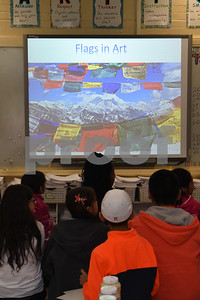 Caldwell students attend a presentation by art student Joanna Gifford before designing their own flags for a collaborative art instillation that will represent the theme of compassion.  (Sarah A. Miller/Tyler Morning Telegraph)