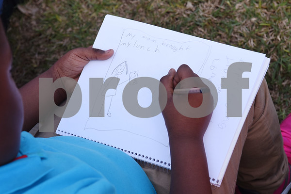 Fourth grader Daisha Allen, 9, draws a design for a flag in her sketchbook Friday March 3, 2017 at Caldwell Elementary Arts Academy. University of Texas at Tyler graduate art student Joanna Gifford is working with Caldwell students on a collaborative art instillation at the school. Flags created by students on the structure will represent the theme of compassion.  (Sarah A. Miller/Tyler Morning Telegraph)