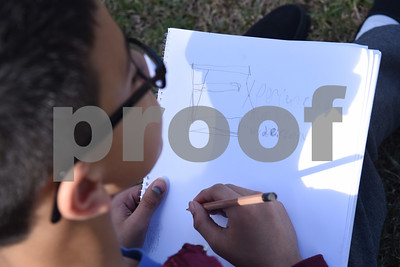 Fourth grader Felix Zavala, 9, draws a design for a flag in her sketchbook Friday March 3, 2017 at Caldwell Elementary Arts Academy. University of Texas at Tyler graduate art student Joanna Gifford is working with Caldwell students on a collaborative art instillation at the school. Flags created by students on the structure will represent the theme of compassion.  (Sarah A. Miller/Tyler Morning Telegraph)
