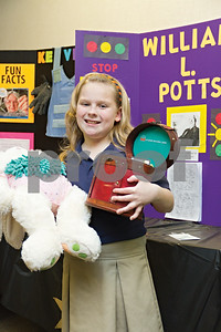 Photo by Shannon Wilson / Tyler Morning Telegraph Marlee Gunter wins first place with her invention of the Onsie Cleaner at the Invention Convention at The Brook Hill School in Bullard.