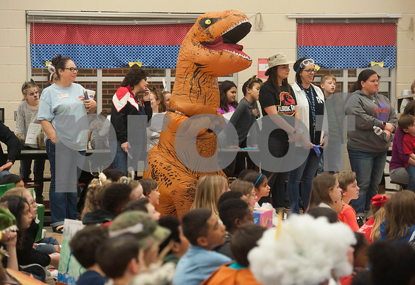 Parents, teachers and even a T-Rex attend the Jack Elementary School science vocabulary parade at the school in Tyler on Friday March 9, 2018.   (Sarah A. Miller/Tyler Morning Telegraph)