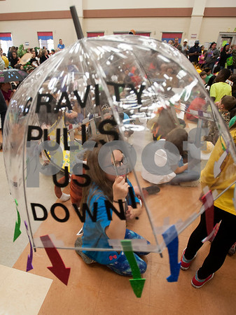 Jack Elementary School Katelyn Martinez made a gravity-themed costume using an umbrella during a science vocabulary parade at the school in Tyler on Friday March 9, 2018.   (Sarah A. Miller/Tyler Morning Telegraph)