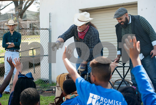 """Cowboy James Chandless demonstrates items cowboys use during a special event with Bridgette Booth, author of children's chapter book """"Tales from Burnt Boot Creek: The Cowboy's Golden Cup"""" at Promise Academy in Tyler on Friday March 9, 2018.   (Sarah A. Miller/Tyler Morning Telegraph)"""
