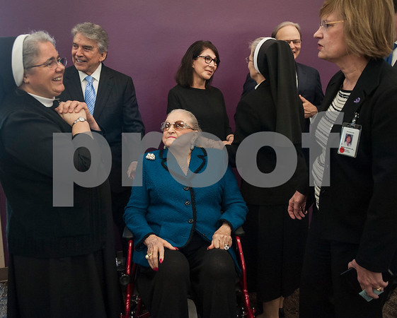 Joseph Z. Ornelas, second from left, and Louise H. Ornelas, center, are greeted by Christus Trinity Mother Frances officials and chaplains after an announcement on Thursday March, 1, 2018 that Christus Trinity Mother Frances Health System plans to expand the Neonatal Intensive Care and Labor and Delivery Units at Christus Mother Frances Hospital – Tyler. The Ornelases as well as John and Lucy Carr are lead donors in the project.  (Sarah A. Miller/Tyler Morning Telegraph)