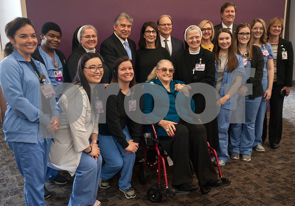 Lead project donors Joseph Z. Ornelas and Louise H. Ornelas as well as Lucy and John Carr are surrounded by Christus Trinity Mother Frances administrators and nurses after an announcement on Thursday March, 1, 2018 that Christus Trinity Mother Frances Health System plans to expand the Neonatal Intensive Care and Labor and Delivery Units at Christus Mother Frances Hospital – Tyler.   (Sarah A. Miller/Tyler Morning Telegraph)