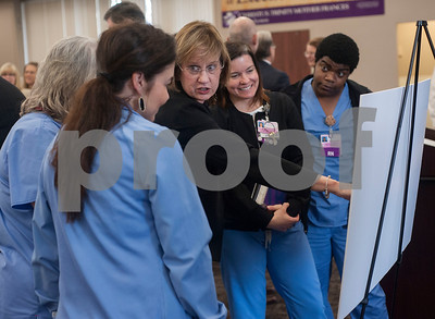 Dr. Brenda Morris  and nurses from Christus Trinity Mother Frances look at the blueprints for an expansion of the Neonatal Intensive Care and Labor and Delivery Units at Christus Mother Frances Hospital – Tyler during a press conference on Thursday March, 1, 2018.  (Sarah A. Miller/Tyler Morning Telegraph)
