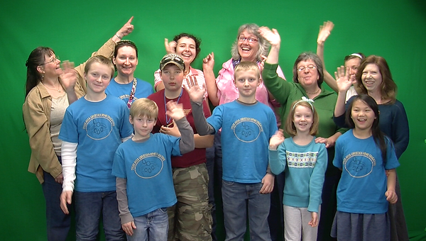 In front of the green screen