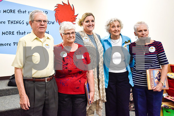 Bobby Smith, Joyce McCormac, The Hamptons activity director Suzanne Henson, Blanche Bergmeier and Sandra Byrd pose for a photo at Dixie Elementary School in Tyler, Texas, on March 20, 2017. Seniors from The Hamptons volunteered their time to read to the elementary schoolers to encourage reading. (Chelsea Purgahn/Tyler Morning Telegraph)