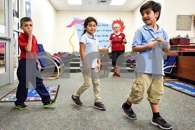 Joyce McCormac, second from right, watches as students walk into the library at Dixie Elementary School in Tyler, Texas, on March 20, 2017. Seniors from The Hamptons volunteered their time to read to the elementary schoolers to encourage reading. (Chelsea Purgahn/Tyler Morning Telegraph)