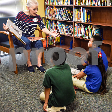 Sandra Byrd reads to a group of students at Dixie Elementary School in Tyler, Texas, on March 20, 2017. Seniors from The Hamptons volunteered their time to read to the elementary schoolers to encourage reading. (Chelsea Purgahn/Tyler Morning Telegraph)