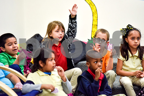 Students listen to Joyce McCormick, not pictured, read a book at Dixie Elementary School in Tyler, Texas, on March 20, 2017. Seniors from The Hamptons volunteered their time to read to the elementary schoolers to encourage reading. (Chelsea Purgahn/Tyler Morning Telegraph)