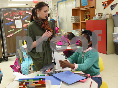 Teacher Jessica Tarrant talks with fourth grader Zoe Ruffin, 10, as she works on a project in her science class at the University of Texas at Tyler Innovation Academy Tuesday March 7, 2017. The Innovation Academy is a public university Charter School that prepares its students to enroll in a STEM (science, technology, engineering, and math programs) major at in college.  (Sarah A. Miller/Tyler Morning Telegraph)