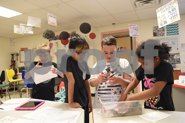 Cody Mullins, 10, Caden Arreguin, 10, Gavin Green, 10, and Zhana Clary, 9, work together on a science at the University of Texas at Tyler Innovation Academy Tuesday March 7, 2017. The Innovation Academy is a public university Charter School that prepares its students to enroll in a STEM (science, technology, engineering, and math programs) major at in college.  (Sarah A. Miller/Tyler Morning Telegraph)