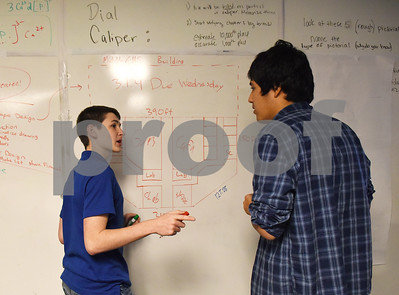 John Daniel, 16, and Michael Palady, 16, draw out a floor plan of their project designing a school in their civil engineering class at the University of Texas at Tyler Innovation Academy Tuesday March 7, 2017. The Innovation Academy is a public university Charter School that prepares its students to enroll in a STEM (science, technology, engineering, and math programs) major at in college.  (Sarah A. Miller/Tyler Morning Telegraph)