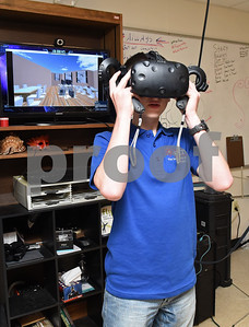 John Daniel, 16, demonstrates navigating a virtual reality school he created outside of class at the University of Texas at Tyler Innovation Academy Tuesday March 7, 2017. The Innovation Academy is a public university Charter School that prepares its students to enroll in a STEM (science, technology, engineering, and math programs) major at in college.  (Sarah A. Miller/Tyler Morning Telegraph)