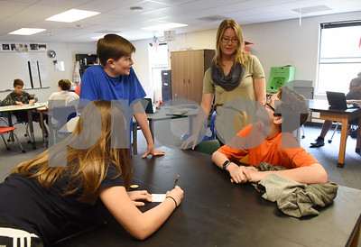 Science co-teacher Ashley Brooks talks with eight grade students Elexis Wiebe, 14, David Huntsberger, 13, and Cristen Chittenden, 13, at the University of Texas at Tyler Innovation Academy Tuesday March 7, 2017. The Innovation Academy is a public university Charter School that prepares its students to enroll in a STEM (science, technology, engineering, and math programs) major at in college.  (Sarah A. Miller/Tyler Morning Telegraph)