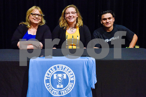 Audrey West, center, and family pose for a photo during signing day at Whitehouse High School in Whitehouse, Texas, on Tuesday, March 21, 2017. West will be an athletic trainer at Texas Lutheran. (Chelsea Purgahn/Tyler Morning Telegraph)