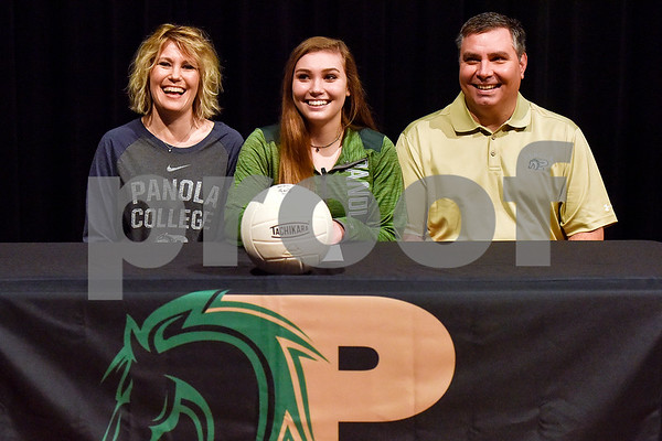Molly Harris, center, and her family pose for a photo during signing day at Whitehouse High School in Whitehouse, Texas, on Tuesday, March 21, 2017. Harris will be playing volleyball at Panola College. (Chelsea Purgahn/Tyler Morning Telegraph)