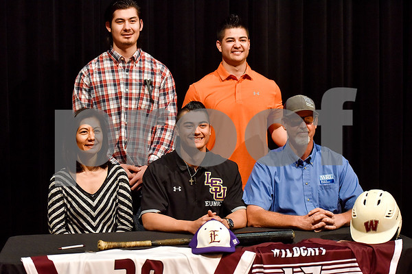 Mason House, center, and family pose for a photo during signing day at Whitehouse High School in Whitehouse, Texas, on Tuesday, March 21, 2017. House will be playing baseball for LSU Eunice. (Chelsea Purgahn/Tyler Morning Telegraph)