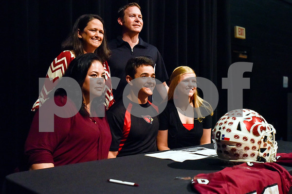 Eddie Godina, center, and family pose for a photo during signing day at Whitehouse High School in Whitehouse, Texas, on Tuesday, March 21, 2017. Godina will be playing football at Trinity Valley. (Chelsea Purgahn/Tyler Morning Telegraph)