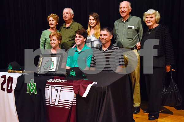 Bryce Cundieff, bottom center, and family pose for a photo during signing day at Whitehouse High School in Whitehouse, Texas, on Tuesday, March 21, 2017. Cundieff will be playing baseball at Arkansas Monticello. (Chelsea Purgahn/Tyler Morning Telegraph)