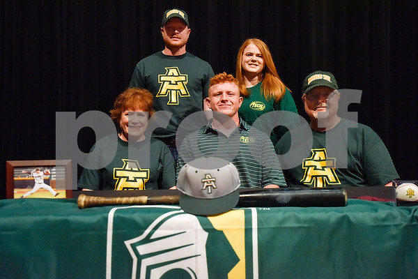 Patrick Miner, center, and family pose for a photo during signing day at Whitehouse High School in Whitehouse, Texas, on Tuesday, March 21, 2017. Miner will be playing baseball at Arkansas Tech. (Chelsea Purgahn/Tyler Morning Telegraph)
