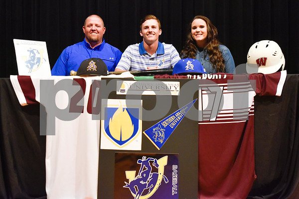Clayton Pruitt, center, and family pose for a photo during signing day at Whitehouse High School in Whitehouse, Texas, on Tuesday, March 21, 2017. Pruitt will be playing baseball for Southern Arkansas University. (Chelsea Purgahn/Tyler Morning Telegraph)
